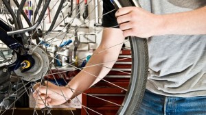 Man fixes bike tyre