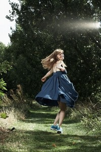 Sophie twirling around in a blue dress
