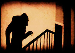 shadow of vampire creeping up the stairs