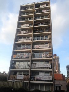 block of flats with banners on balconies